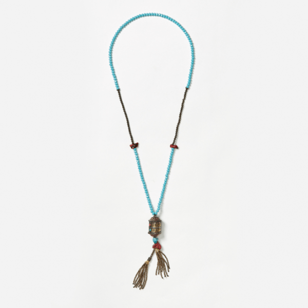 beaded neckpiece with scroll and tassel