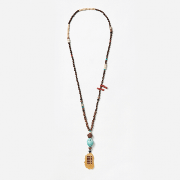 beaded neckpiece with ethnic abacus pendant