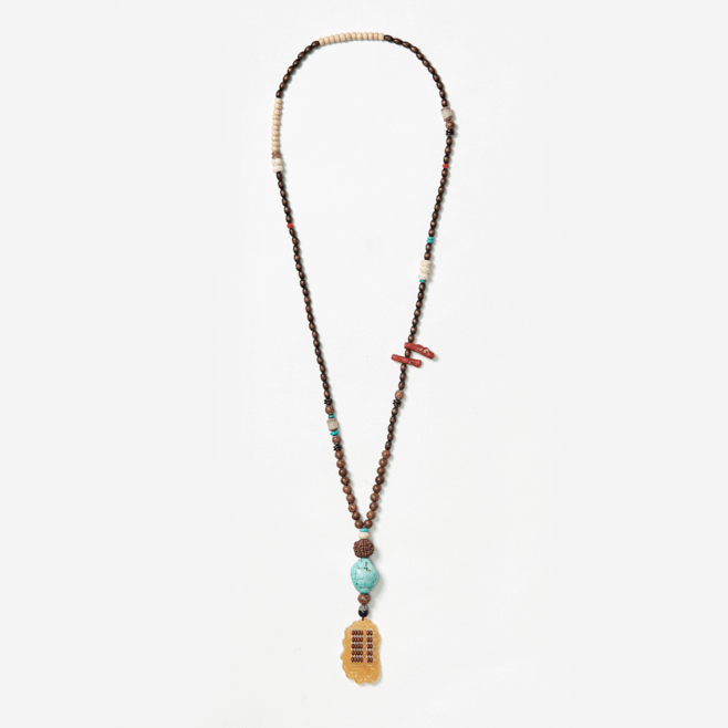 beaded neckpiece with ethnic abacus pendant