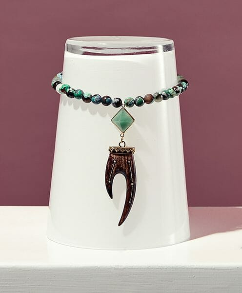 claw pendant with green stone and green agate on adjustable suede lifestyle