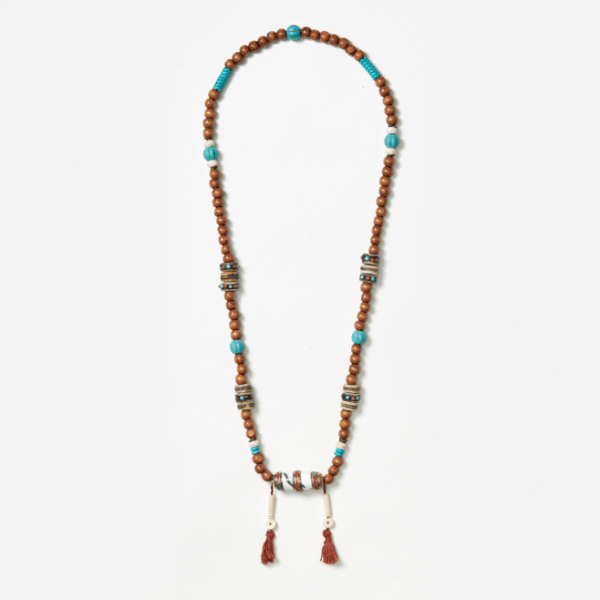 neckpiece with bullet bead and tassels
