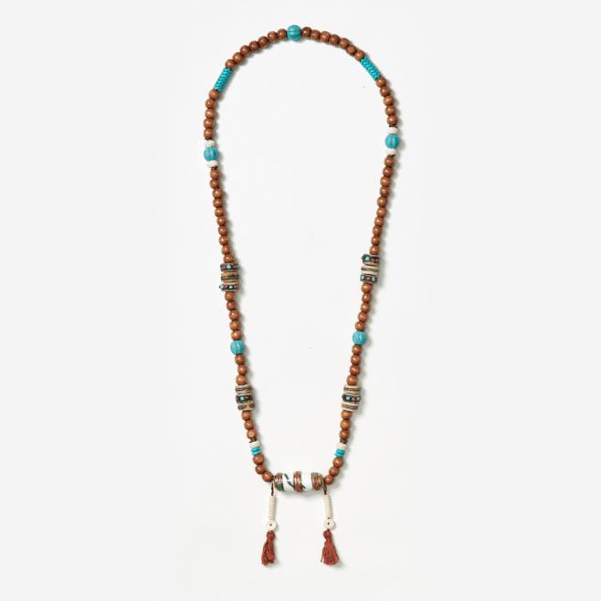 neckpiece with bullet bead and tassels
