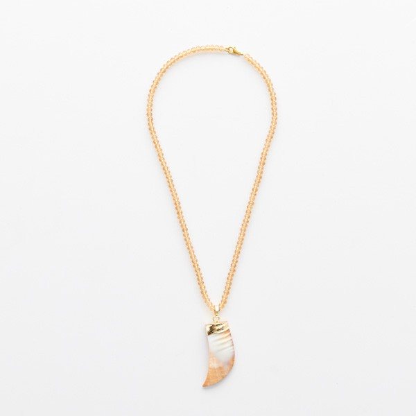 Bone Tusk on Beige Beads
