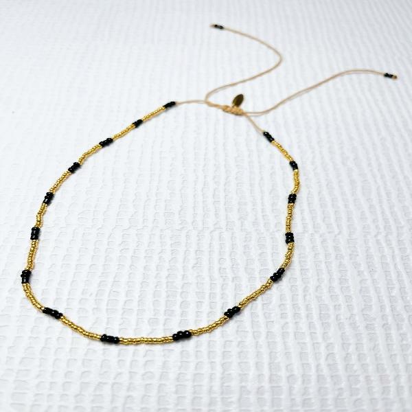 Adjustable Black and Gold Neckpiece